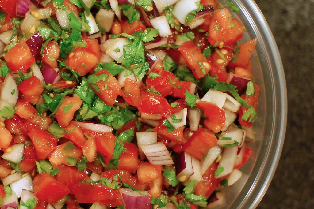 Pico de gallo is a great way to use up any seasonal vegetables or herbs. Image from user bradleypjohnson on Flickr.