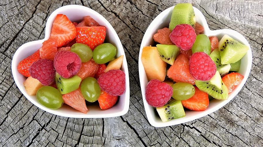 Prepping a big batch of fruit salad to eat throughout the week is a great way to stay healthy and hydrated.