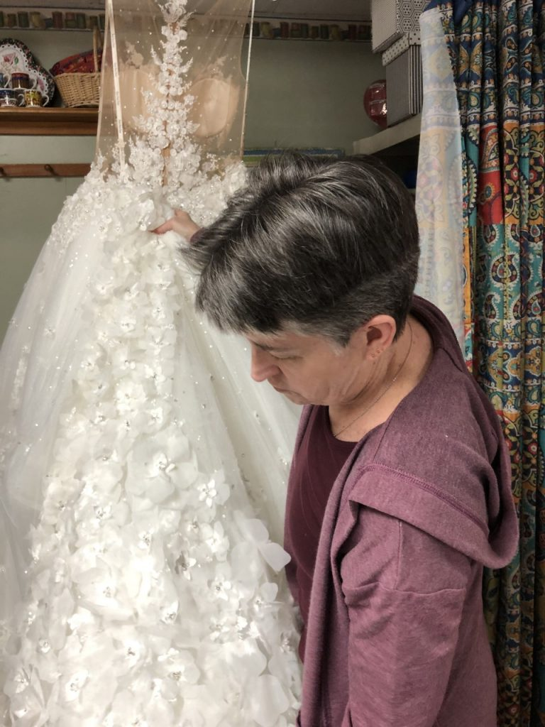 After making masks for 6 months, Barbara Jenkins is thankful to be back altering wedding gowns.