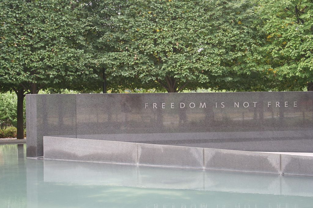 "A granite wall at the Korean War Memorial reads, ""FREEDOM IS NOT FREE"""