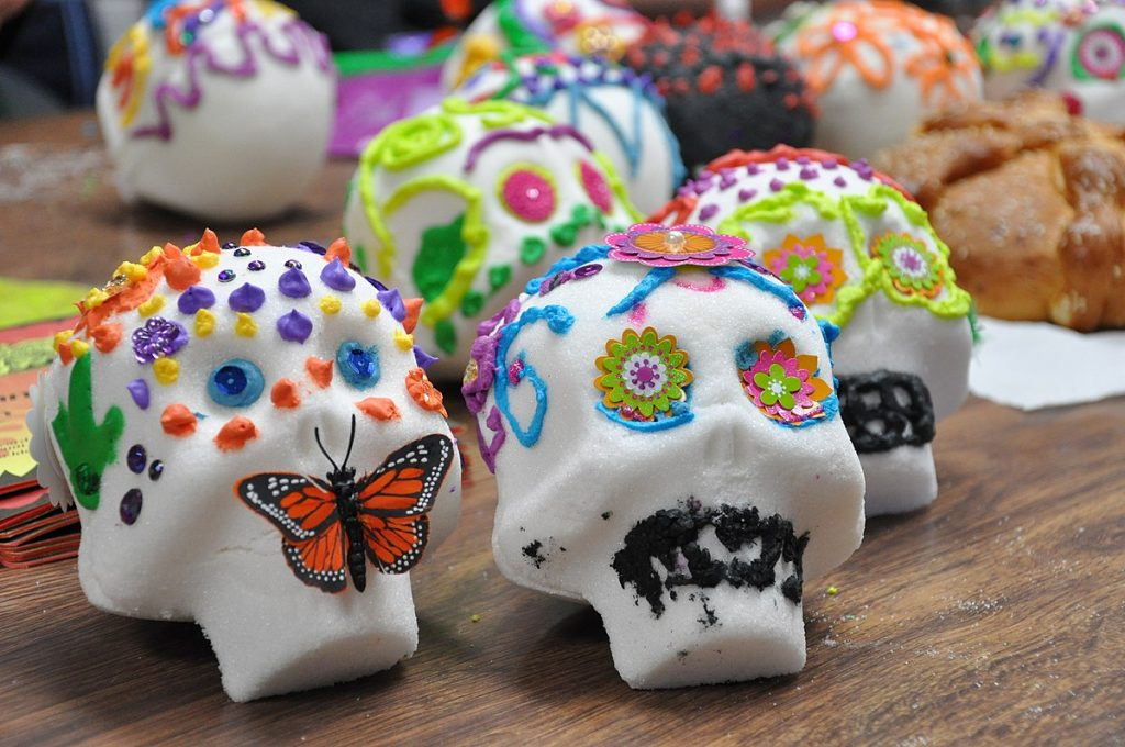As the name suggests, sugar skulls are made of white sugar molded into the shape of skulls. Families will decorate these skulls during Día de los Muertos as decorative offers to the dead.
